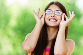Young woman glasses smiling — Stock Photo