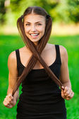 Young, long-haired woman — Stock Photo