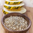 Plate with raw oatmeal — Stock Photo