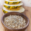 Plate with raw oatmeal - Stock Photo