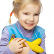 Little smiling girl with bananas — Stock Photo