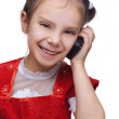 Little smiling girl with phone — Stock Photo #9579084