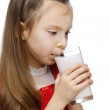 Little girl drinks milk — Stock Photo #9579085