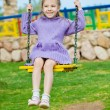 Little girl sits on swing — Stock Photo #9579093