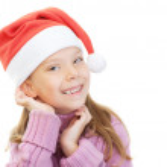 Little girl in Christmas hat smiles — Stock Photo #9579107