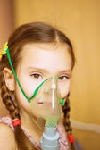 Small girl with inhalator — Stock Photo