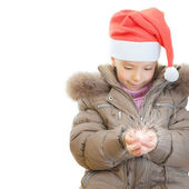 Little girl Christmas hatkeeps shining ball — Stock Photo
