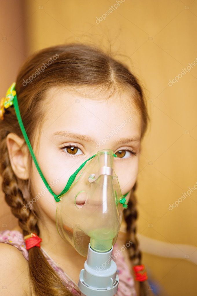 Small girl with inhalator in hospital. — Stock Photo #9579077