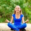 Teenage girl sitting in lotus position — Stock Photo #9793840