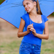 Teenager girl holding umbrellas — Stock Photo #9793841