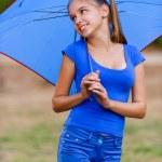 Teenager girl holding umbrellas — Stock Photo