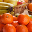 Tangerines, bananas, apples and oranges - Stock Photo