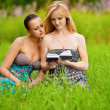 Stock Photo: Two beautiful girls reading book