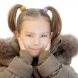 Little girl in brown jacket — Stock Photo #9795369