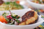 Bowl of salad (radishes, tomatoes, parsley, eggs), meat katlety — Stock Photo