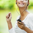 Beautiful woman listening to music — Stock Photo #9894612