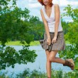 Beautiful woman standing near lake — Foto Stock
