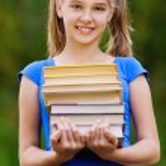 Teenager girl holding stack of seven books — Stock Photo