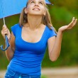 Stock Photo: Teenager girl holding umbrellas