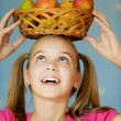 Girl-teenager keeps on his head basket — Stock Photo