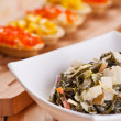 Tartlets with crab salad, corn and seaweed - Stock Photo