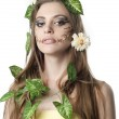 Beautiful young woman with flowers, leaves in her hair and origi — Stock Photo #10678114