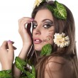 Beautiful young woman with flowers, leaves in her hair and origi — Stock Photo #10678208