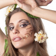 Portrait of beautiful young lady with flower and leaf in her ha — Stock Photo