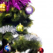 Christmas Tree background with colored toys — Stock Photo