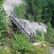 Old open-cast mine with wood stair - Stock Photo