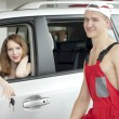 Stock Photo: Young woman and man near car