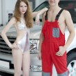Young pretty woman and man near car — Stock Photo
