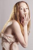 Beautiful woman with gold lips — Stock Photo