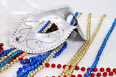 Background with Carnival silver Mask and beads — Stock Photo