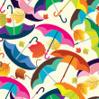 Seamless background with colorful umbrellas — Stock Vector