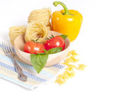 Tomato, macaroni and green basil — Stock Photo
