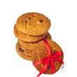 Biscuit cookies with chocolate and a red ribbon — Stock Photo
