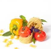Tomato, macaroni red and green basil — Stock Photo
