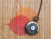 Pocket watch on a wooden mat — Stock Photo