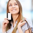 Girl with a credit card — Stock Photo