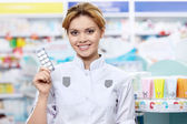 Pharmacist with tablets — Stock Photo
