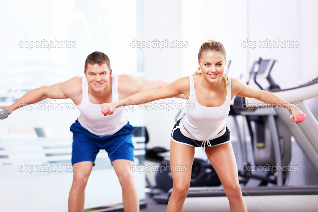 Smiling in the fitness club — Stock Photo #10633572