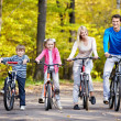 Families with children on bicycles — Stock Photo