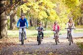 Family on bikes — Stock Photo