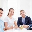 Consultant and a young couple at home — Stock Photo