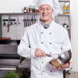 The cook in the kitchen — Stock Photo