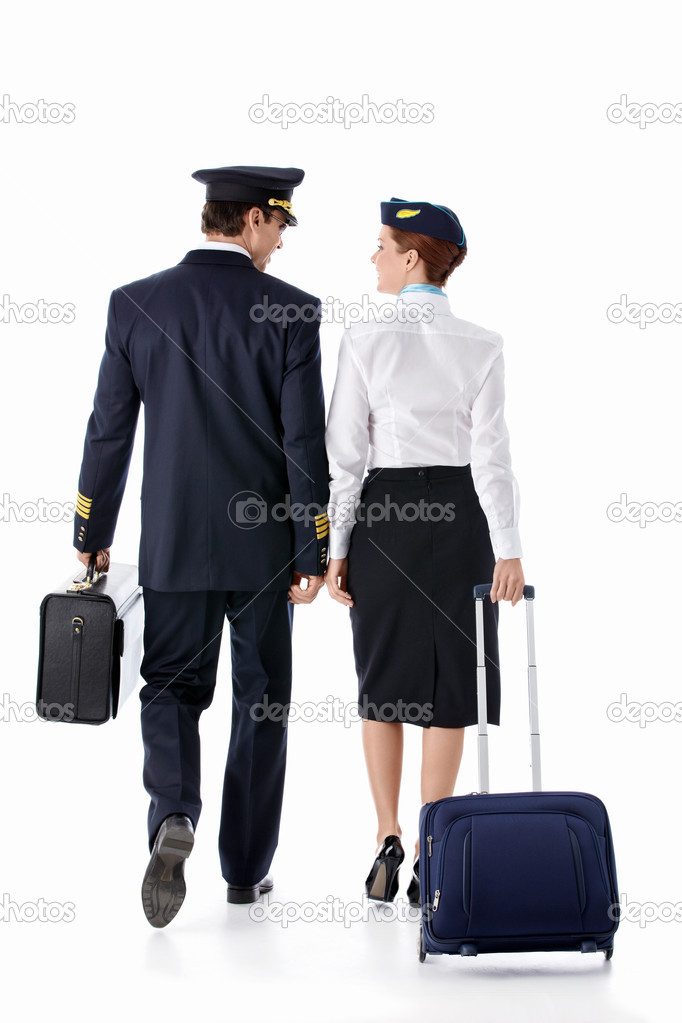 The pilot and stewardess with a suitcase on a white background  Stock Photo #9683673