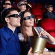 Watch a movie in 3D glasses — Stock Photo #9966218