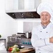 Cook in the kitchen — Stock Photo