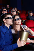 Watch a movie in 3D glasses — Stock Photo
